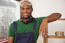 Portrait of man renovating new apartment — Stock Photo