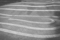 Full frame view of asphalt with white marking lines — Stock Photo