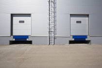 Exterior view of warehouse metal facade with ladder — Stock Photo