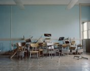 Pile of broken chairs in abandoned school — Stock Photo