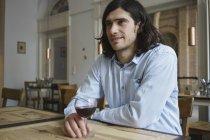 Happy man having wine while sitting at cafe — Stock Photo