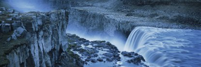 High angle view of waterfall from rocky cliff, Dettifoss, Iceland — Stock Photo