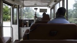 Rear view of two men riding on bus — Stock Photo