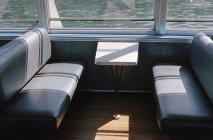 Empty bench seats inside ferry — Stock Photo