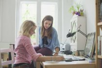 Young female university students studying at home — Stock Photo