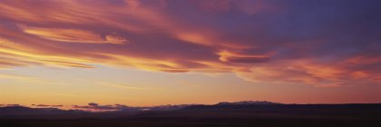 Panoramic view of landscape with orange sky during sunset — Stock Photo