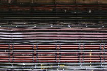 Full frame shot of cables mounted on old wall — Stock Photo