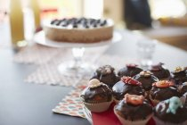 Close up view of cakes on stand at dining table — стоковое фото