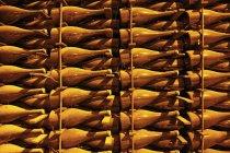 Full frame shot of bottles of champagne in rack — Stock Photo