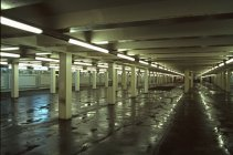 Interior view of empty parking garage at night — Stock Photo
