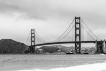 View of Golden Gate Bridge over bay of water against sky, San Francisco, California, USA — Stock Photo