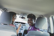 Portrait of happy female friends sitting in car — Stock Photo