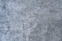 Coup de plein cadre de mur de béton gris — Photo de stock