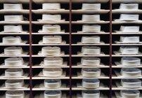 Full frame shot of folded shirts on clothes rack — Stock Photo