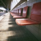 Close up view of red plastic seats in row — Stock Photo