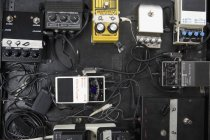 Full frame shot of guitar pedals on pedalboard — Stock Photo
