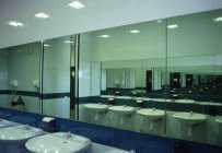 Row of wash basins and mirrors in public bathroom — Stock Photo