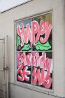 Christmas greeting lettering painted on window — Stock Photo