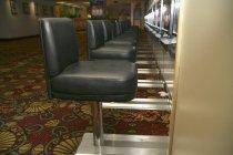 Row of empty slot machines seats in casino — Stock Photo