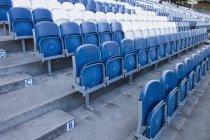Rows of empty plastic stadium seating — Stock Photo