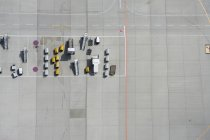 Aerial view of loading stairs vans on tarmac at airport — Stock Photo