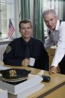 Portrait of Two police officers working in office — Stock Photo