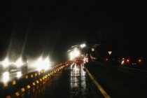 Traffic driving along highway at night — Stock Photo