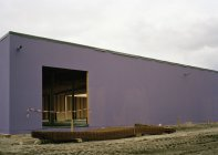 Exterior of violet building site on cloudy day — Stock Photo