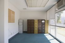 Interior of office room with filing cabinets — Stock Photo