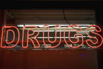 Lit neon sign with drug lettering — Stock Photo