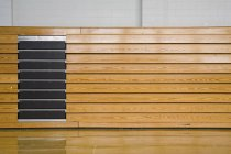 Side view of stacked bleachers in sports hall — Stock Photo