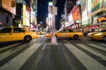 Taxis driving on Times Square in Manhattan — Stock Photo