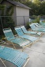Sun loungers placed at back yard in row — Stock Photo