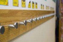 Coat rack in primary school — Stock Photo