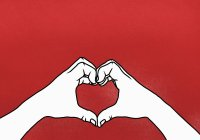 Cropped hands of person making heart shape against red background — Stock Photo