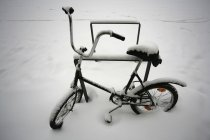 Bicycle covered in snow at outdoor — Stock Photo
