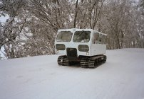 Tracked vehicle on snowy road at nature — Stock Photo