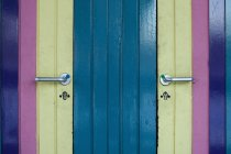 Full frame shot of colorful painted doors — Stock Photo