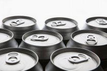 Aluminum drink cans on white backdrop — Stock Photo
