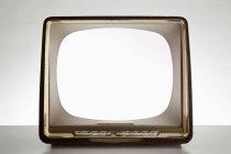 Televisione dell'annata con schermo in bianco illuminato — Foto stock