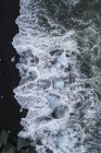 Aerial view of ice pieces in surfing wave — Stock Photo