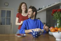 Happy  couple enjoying at table with breakfast in room — Stock Photo