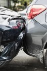 Damaged bumpers from car accident — Stock Photo