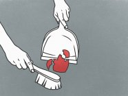 Person sweeping broken heart into dustpan — Stock Photo