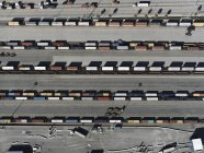 Aerial view trains in sunny shunting yard, Los Angeles, California, USA — Stock Photo
