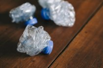 Crumpled, recycled plastic water bottles — Stock Photo