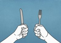 Hungry hands holding fork and knife — Stock Photo
