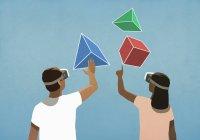 Пара с симуляторами виртуальной реальности, смотрящими вверх на геометрические фигуры — стоковое фото