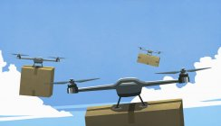 Drones flying in sky, delivering cardboard box packages — Stock Photo
