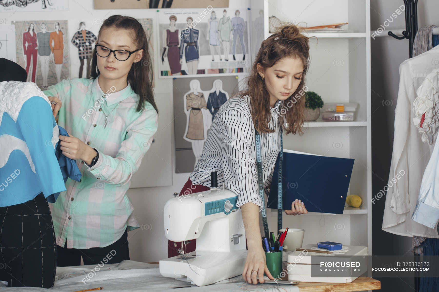 Assistant And Female Fashion Designer Working In Studio Teenager Indoors Stock Photo 178116122